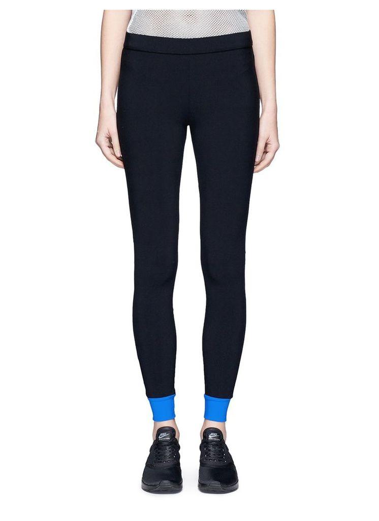 Colourblock performance leggings with gummed zip pouch