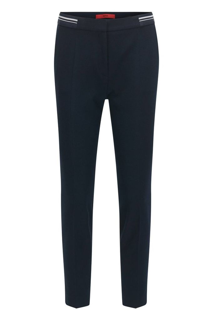 Slim-fit trousers in piqué fabric