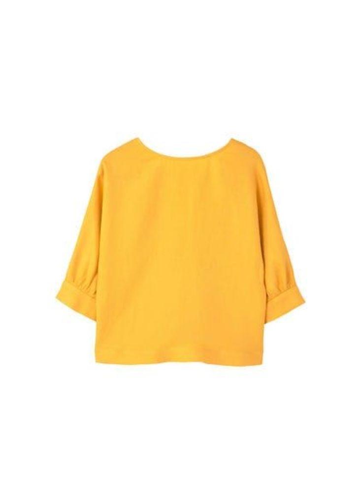 Back bow blouse