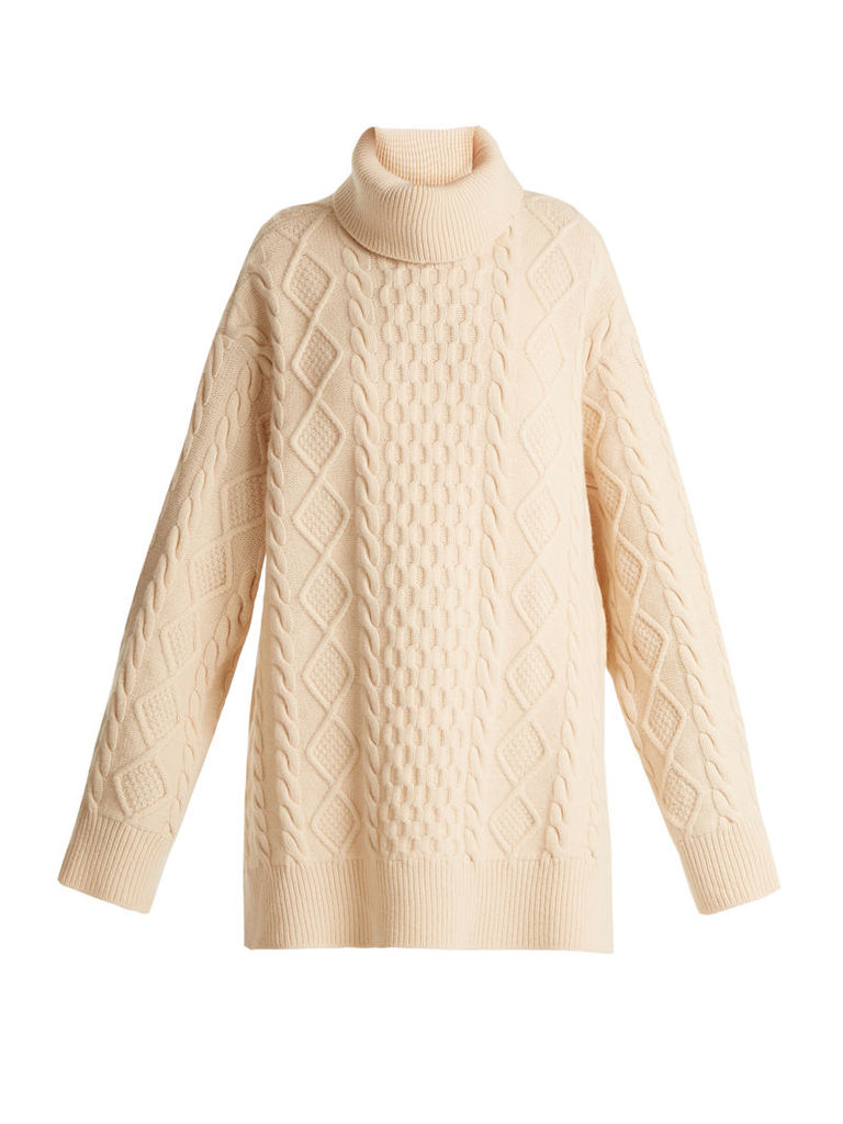 Split-side roll-neck wool cable sweater