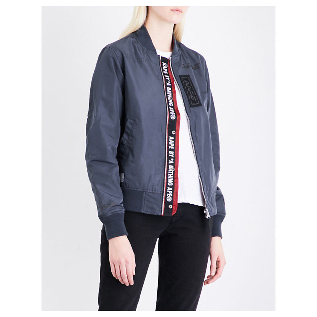 Reversible patch-embroidered shell jacket