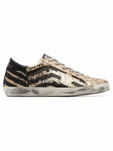 Golden Goose black and metallic gold superstar leather sneakers