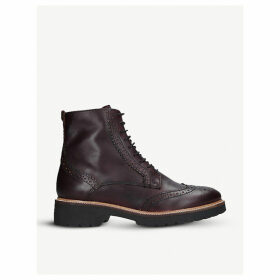 Snail brogue-style leather boots