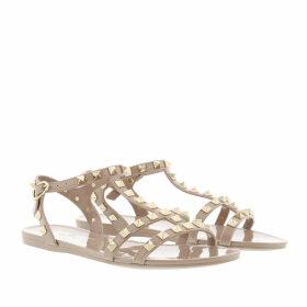 Valentino Sandals - Rockstud Flat Sandals Soft PVC Poudre - beige - Sandals for ladies