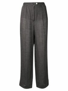 Krizia Pre-Owned 1970's pinstriped tapered trousers - Grey