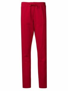 Alexandre Vauthier embellished brooch track pants - Red