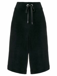 No Ka' Oi side stripes long shorts - Black