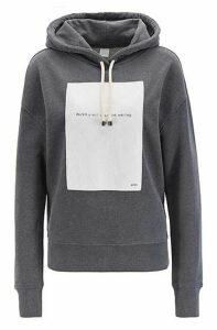 Oversized-fit hooded sweatshirt with slogan panel