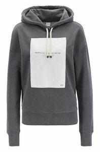Oversized-fit hooded sweatshirt with slogan panel