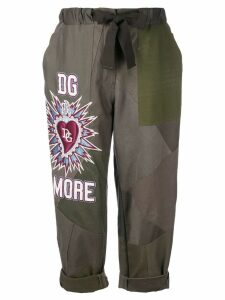 Dolce & Gabbana patchwork logo cropped trousers - Green