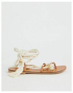 ASOS DESIGN Fields embellished tie leg flat sandals-Beige