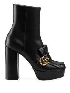 Gucci leather ankle boot with plateau and fringe - Black