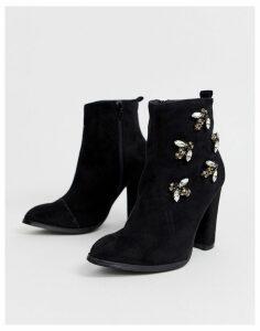Glamorous heeled boots with bee embellishment-Black