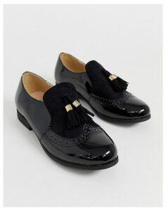 Truffle Collection slip on tassel loafer in black