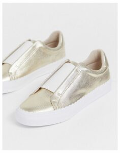 ASOS DESIGN Devoted slip on trainers in champagne gold