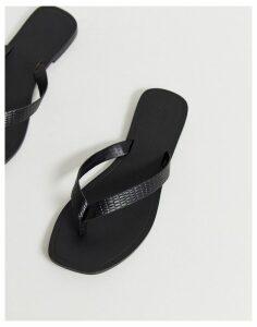 ASOS DESIGN Florence leather flip flop sandals in black croc