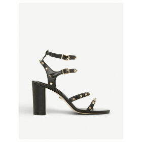 Model studded leather sandals