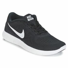 Nike  FREE RUN W  women's Running Trainers in Black