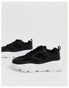 Truffle Collection chunky trainer in black-White
