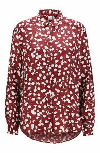 Dot-print blouse with concealed placket