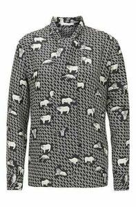 Animal-print tie-neck blouse in silk twill