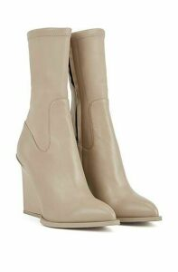 Calf-length boots in Italian leather with feature heel