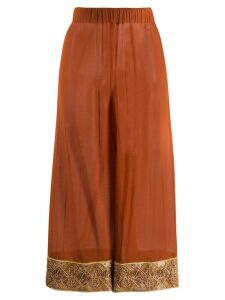 Romeo Gigli Pre-Owned 1990s bead embroidery sheer trousers - Brown