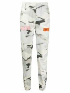 Heron Preston camouflage-print logo track trousers - NEUTRALS