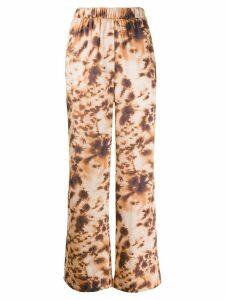Nanushka tie-dye print wide leg trousers - NEUTRALS